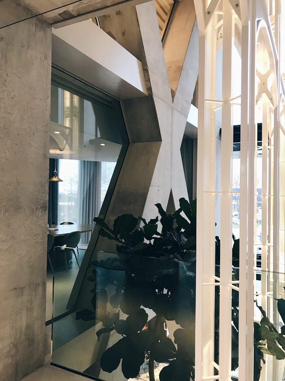 hotel qo amsterdam plants trough glass view